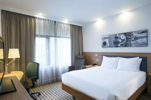 A bed or beds in a room at Hampton by Hilton Amsterdam Airport Schiphol