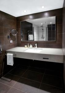 Een badkamer bij Quality Hotel Waterfront