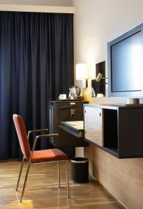 Een TV en/of entertainmentcenter bij Quality Hotel Waterfront
