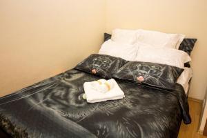 Кровать или кровати в номере Apartment on Yartsevskaya