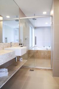 Ванная комната в Vitória Hotel Convention Paulínia