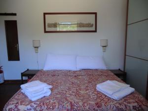 Letto o letti in una camera di La Nepitella