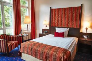 Ein Bett oder Betten in einem Zimmer der Unterkunft Steigenberger Inselhotel