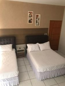 A bed or beds in a room at Hotel Lider