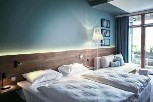 Ein Bett oder Betten in einem Zimmer der Unterkunft Das Sonnreich - Thermenhotel Loipersdorf