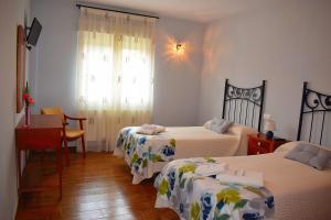 Cama o camas de una habitación en La Primavera