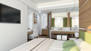 A bed or beds in a room at Stefania Apartments