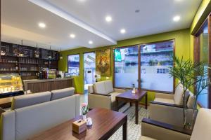 The lounge or bar area at Oasis Kathmandu Hotel
