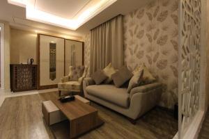 Uma área de estar em Hayat Rose Hotel Apartments