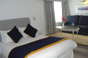 A bed or beds in a room at Trearddur Bay Hotel