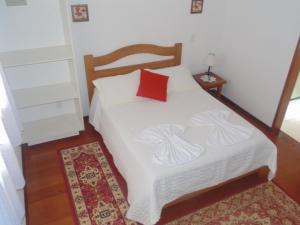 Cama ou camas em um quarto em Chales Marigu