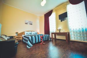 A bed or beds in a room at Europa Hotel-Kutaisi