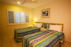 A bed or beds in a room at Coral Horizons