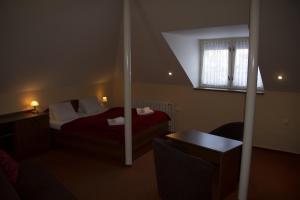 Postel nebo postele na pokoji v ubytování Penzion Oaza