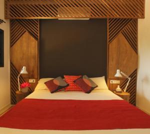 Un ou plusieurs lits dans un hébergement de l'établissement Les Manguiers de Guereo