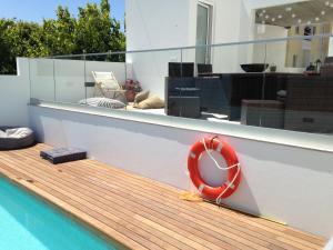 The swimming pool at or near Casa do Joaquim da Praia