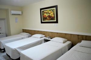 Cama ou camas em um quarto em Hotel Concord