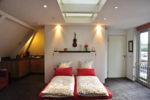 Een bed of bedden in een kamer bij Appartement Bokhamer
