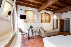 Area soggiorno di Ferrara Rooms