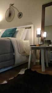 A bed or beds in a room at Apto Novo e Completíssimo