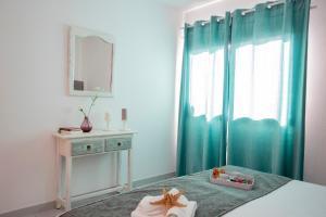 Cama o camas de una habitación en Apartamento Almirante
