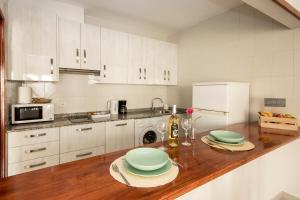 Una cocina o zona de cocina en Apartamento Almirante