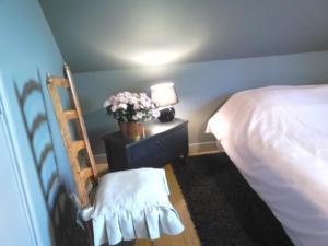 A bed or beds in a room at Soir En Vermandois