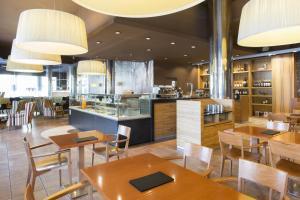 Un restaurante o sitio para comer en Hotel SB Ciutat de Tarragona