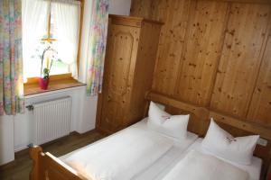 Ein Bett oder Betten in einem Zimmer der Unterkunft Haus Alpenlicht