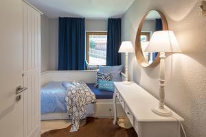 Ein Bett oder Betten in einem Zimmer der Unterkunft Abnoba Mons Design Apartment Lenzkirch