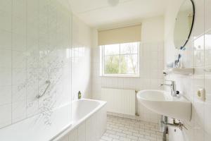 Een badkamer bij Center Parcs Sandur Emmen