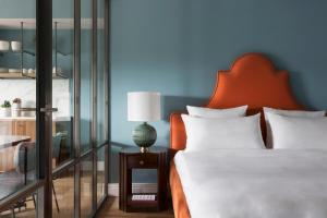A bed or beds in a room at Hotel TWENTY EIGHT