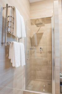 Ванная комната в Апартаменты Малон