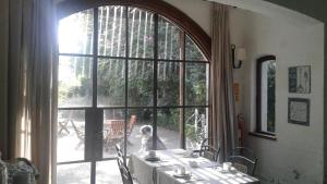 Un restaurant u otro lugar para comer en Hotel Boutique Casagrande