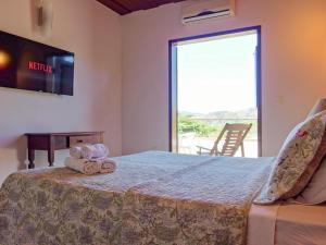 A bed or beds in a room at Pousada Solar D Alcina
