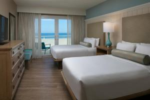 A bed or beds in a room at Edgewater Beach Hotel