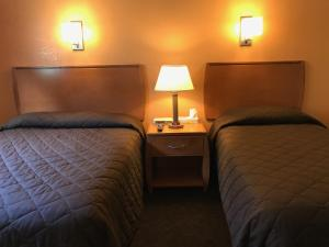 A bed or beds in a room at Shelikof Lodge