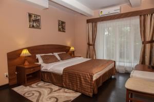A bed or beds in a room at Morion Hotel