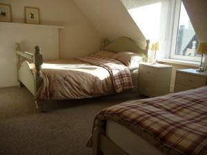 A bed or beds in a room at Aberlour Retreat