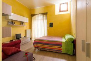 Letto o letti in una camera di Maisonrua'