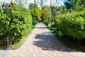 A garden outside Grand Sport Hotel