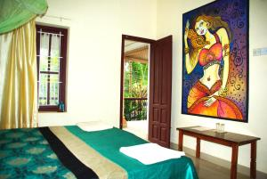 A bed or beds in a room at Aryavilla Heritage