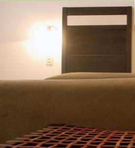 A bed or beds in a room at Hotel de Las Nubes