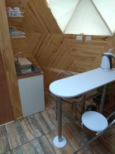 A kitchen or kitchenette at Domos Ocoa