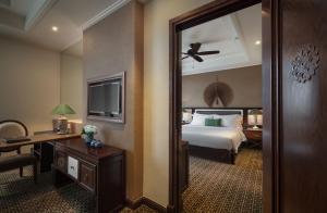 Un ou plusieurs lits dans un hébergement de l'établissement Ninh Binh Hidden Charm Hotel & Resort