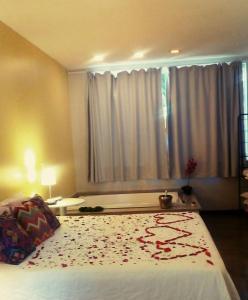 Cama ou camas em um quarto em Pousada Casa das Flores