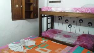 A bed or beds in a room at Hotel Villas de San Diego
