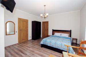 Кровать или кровати в номере Гостевой дом Райзен Хаус