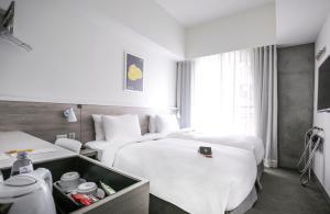 シティイン ホテル プラス - ファクシング ノース ロード ブランチにあるベッド