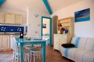 A seating area at Residence Hotel Lu Nibareddu